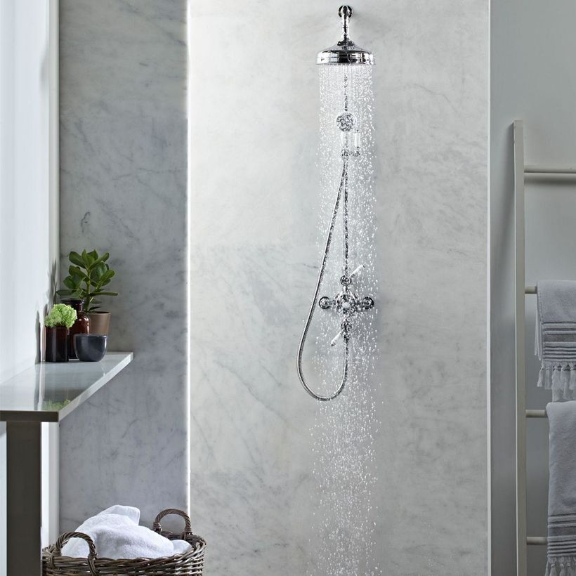traditional exposed shower with marble shower wall